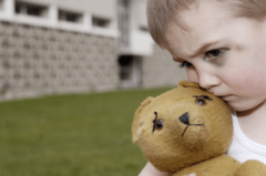 abused-child-with-teddy-bear.png